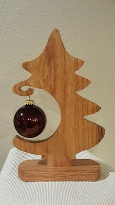 This doesn't ha cut on the bandsaw or CNC but only engraved and/or painted and the hole can be done with a drill and the proper hole sawX-Mas Tree Ornament HolderCute way to display special ornamentsScroll saw christmas tree decorationInstant Access Christmas Wood Crafts, Wood Christmas Tree, Christmas Art, Christmas Projects, Wooden Christmas Decorations, Wooden Xmas Trees, Woodworking Christmas Gifts, Minimalist Christmas Tree, Wooden Ornaments
