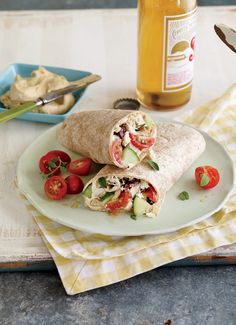 Make a nutritious lunch in no time flat with Greek style chicken wraps by combining rotisserie chicken, veggies and hummus on a flour tortilla.