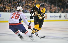 Lucic shoots the puck ~ Bruins vs Capitals, Game 1 of Playoffs! Milan Lucic, Boston Sports, First Game, Sports Pictures, Boston Bruins, Game 1, Nhl, Olympics, Photo Galleries