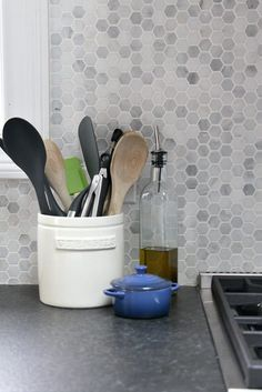 Creating A Modern Farmhouse Inspired Kitchen - Bathroom Granite - Ideas of Bathroom Granite - Creating a modern farmhouse-inspired kitchen with white cabinets dark granite counter tops custom wood hood vent and a full tile wall backsplash! Backsplash With Dark Cabinets, Dark Countertops, Kitchen Countertops, Backsplash Ideas, Backsplash Design, Tile Ideas, Kitchen Cabinets, Oak Cabinets, Hexagon Backsplash