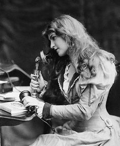 She was so modern that she sat at her desk and made a phone call instead of writing a letter.