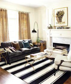 Punchy living room with gray velvet sofa