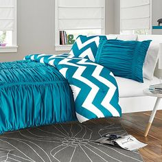 Dress your bed in the bright and bold Reagan Comforter Set. Adorned with a ruched textured fabric in a beautiful shade of peacock blue, the completely reversible bedding is the perfect way to liven up your bedroom.