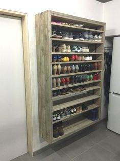 Pallet Furniture Projects Giant Shoe Rack Made Out Of Discarded Pallets Entrance Pallet Projects Pallet Shelves - This giant pallet shoe rack was made from discarded pallets and planks, roughly sanded, brushed and gray wash. Garage Organization, Garage Storage, Shoe Storage In Garage, Cheap Storage, Woodworking Organization, Shoe Storage In Cupboard, Shoe Storage In Mudroom, Diy Storage, Mud Room In Garage