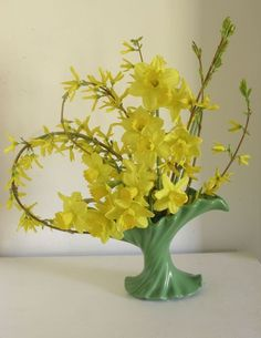 Some of my favorite fresh early spring flowers - daffodills and branches of forsythia