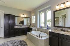 Gehan Homes Master Bathroom - Arched windows, dual sinks, drop in tub, dark wood cabinets, backsplash, granite countertop. Houston, Texas   Lakes of Mission Grove - Oriole #Gehanhomes