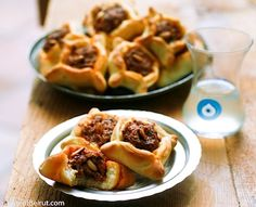 Mini meat pies with a scrumptious ground lamb mixture mixed with onion parsley tomatoes pomegranate molasses tahini and drained yogurt Lebanese Meat Pies, Lebanese Cuisine, Lebanese Recipes, Fatayer, Empanada, Savory Pastry, Ground Lamb, Eastern Cuisine, Middle Eastern Recipes