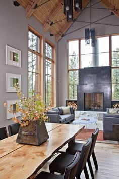 This somehow manages to be stunning and cozy all at once.  Hate the wall color, though.
