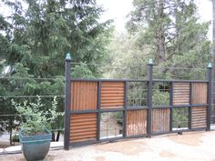 We used old corrugated roofing and rebar to create an interesting fence.