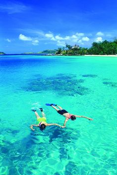 Snorkelling in the warm azure waters of the famous Blue Lagoon at Turtle Island