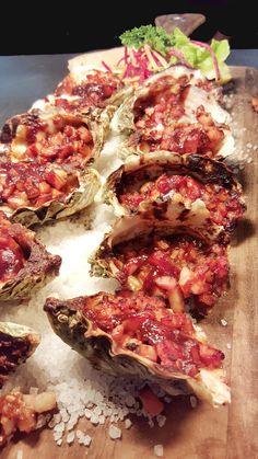 Oysters Kilpatrick. http://www.acrossthewaves.com/?p=dining