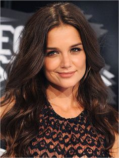 Katie looks alluring with bouncy waves set with her trademark middle part.