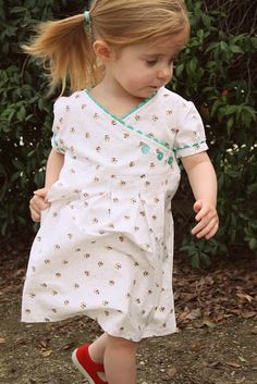 I love how sweet this little dress is. The ric rac edging is just so cute! (and the little buttons! I love buttons!)