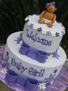A baby shower cake! I'D CHANGE IT TO: pink & white, with a much lighter tiny person on top since I'm so pale lol