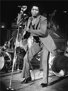 """James Joseph Brown (May 3, 1933 – December 25, 2006) was a singer, songwriter, musician, and recording artist. In a career that spanned six decades, Brown moved on a continuum of blues and gospel-based forms and styles to a profoundly """"Africanized"""" approach to music making. First coming to national public attention in the mid 1950's as a member of the R B singing group The Famous Flames, Brown performed in concerts, first making his rounds across the country and the world."""