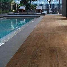 "Enjoy a ""Wood""  pool deck without ever having to refinish it.  Nature Porcleain collection in Bisque - 6'' x 47'' and 8'' x 47''"