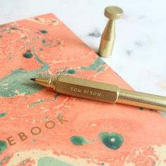 Brass Cog Pen by Tom Dixon - This hexagram model is a dream to write with. We only have a few left, one could be yours!