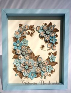 Quilling picture in blue and brown colors ornate with flowers