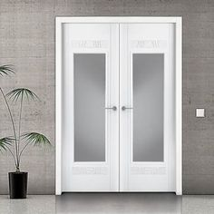 The prefinished Sanrafel Lifestyle 952V Double Fire Door with 1 pane of glass. #sanrafaeldoors