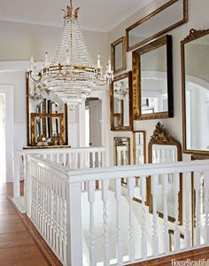 "In the stair hall of Annie Brahler's Jacksonville, Illinois, house, daylight bounces off a Dutch chandelier and assorted mirrors. ""It's great — you double the size of the space,"" she says. Bjorn Wallander  - HouseBeautiful.com"