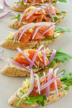 Smoked salmon appetizers with flavored cream cheese, arugula, lemon zest, and topped with sliced red onion. Only 82 calories for each. | joeshealthymeals.com