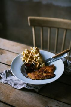Waffles with chicken and maple syrup