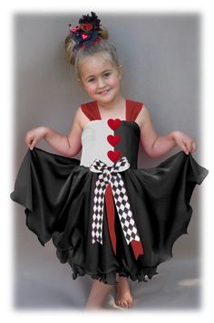 Queen of hearts, Alice in wonderland inspired dress. Bodice: ~ Black and white 100% cotton ~ Straps closes at the back with a big bow ~ Handwash ~ Bodice back is shirred that makes it incredibly easy to put on, and take of. This is especially appreciated when dressing the younger children. Skirt: ~ 3 layers of soft lining, tulle and chiffon with ruffled seamline   ~This is a CUSTOM MADE TO ORDER ITEM ~ We try our best to stay within a 3-5 day make time on all our Custom Made Items but we can…