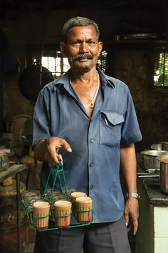 From SAVEUR Issue Wherever you are in India, youre never far from a tea vendor peddling chai, a sweet, milky tea, from trays of steaming glasses. India Culture, Tea Culture, Robert Doisneau, Comida India, Northeast India, Masala Chai, Types Of Tea, Indian Street Food, India People