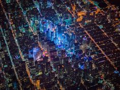This flight required extensive planning and special clearances - we were actually flying ABOVE all of the airline traffic landing at JFK, LGA and Newark airports ... Imagine leaning out of an open door of a helicopter 7,500 feet over New York City on a very dark and chilly night... And seeing this./ night lights