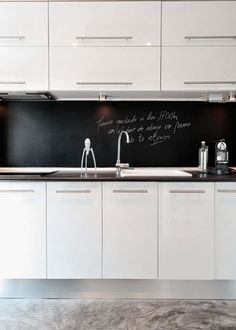kitchenette with chalkboard backsplash.. doing it!