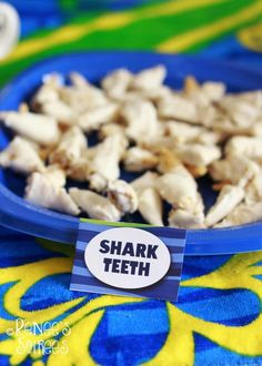 Shark themed party. This has some cute ideas that could be used for any beach themed party!