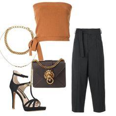 Pantaloni ampi con particolare della fascia in vita, contrasta ed equilibra il top esuberante farnetichi. Gioco di accessori per illuminare l'ourfit, che si chiude con sandali sobri ma soprattutto alti