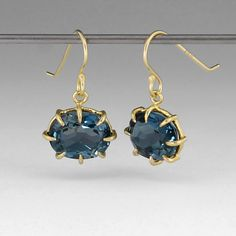 """18k yellow gold, faceted oval small blue topaz. Earrings are 0.75"""" long and 0.5"""" wide."""