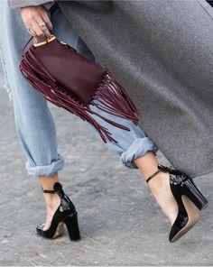 Cuffed distressed denim, oxblood fringe clutch and patent black heels