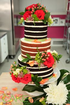 Tiered naked casually chic summer wedding cake with buttercream and fresh flowers. #NakedCake #Baking #Weddings
