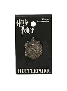 """If you're hard working, patient and fair you just might be a Hufflepuff. And if you're a Hufflepuff, you'll want this small pewter pin from <i>Harry Potter</i> featuring an elegant Hufflepuff crest design. Can also be worn as charm.<ul><li style=""""list-style-position: inside !important; list-style-type: disc !important"""">Approx. 1""""</li><li style=""""list-style-position: inside !important; list-style-type: disc !important"""">Alloy</li><li style=""""list-style-position: inside !important…"""