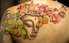 Buddha tattoo with flowers on back