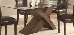 looking for a dining table. I want 1 that's modern with a glass top. Upholstered chairs.
