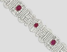 AN ART DECO RUBY AND DIAMOND BRACELET   The wide band designed as two panels composed of circular-cut diamond collets to the central oval-shaped rubies surrounded by baguette-cut diamonds, the remaining openwork plaques each mounted with pavé-set circular-cut diamonds to the smaller oval-shaped rubies with scrolling diamond detail, 1930s, 18.0cm long, with French assay marks for platinum and gold