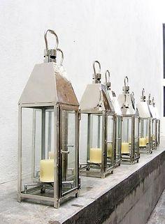 polished nickel finish wrought iron lanterns.