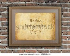 Old wooden frame with written text on an old wall - Be the best version of you - stock photo
