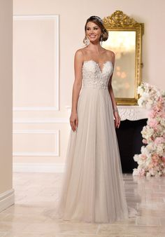 Beaded lace adorns the fitted sweetheart bodice of this elegant French tulle wedding dress from Stella York. At the natural waist, ethereal tulle falls gracefully to the floor and into a chapel train. A beautiful beaded illusion back zips up easily under fabric-covered buttons.  The Knot provides price estimates to give you a general idea of the cost of a dress. Please visit retailers in your area for exact pricing. Prices will vary by region.