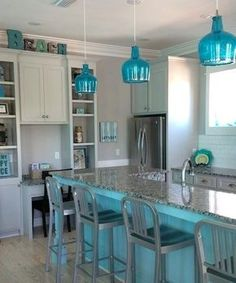 Blue kitchen island and blue glass pendant lights. Featured on Completely Coastal. Florida beach house on islandpendantlights Blue Kitchen Island, Kitchen Island Lighting, Beach Cottage Style, Beach House Decor, Home Decor, Coastal Style, Coastal Decor, Beach House Colors, Decor Room