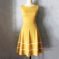 Coquette Dress Mustard, $39, now featured on Fab.