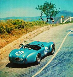 The Shelby American entry of Dan Gurney and Jerry Grant thunders through the sun baked Sicilian hills during the torturous 1964 Targa Florio. Gurney and Grant managed an 8th place finish behind the victorious Porsche 904 GTS.