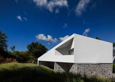 A new crisp white addition sits on top of the old granite walls of this house in Portugal.