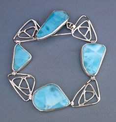 Beautiful larimar - a rare stone that reminds me of blue-skied days, or looking down through clear, tropical waters.