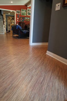 Tarkett Japanese Seagrass Laminate floors installed on diagonal to invite guests into the home.  Great colors in this artfully-designed space!!
