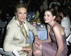 Julie Andrews and Anne Hathaway (literally my expression if Julie Andrews as holding my hand.)