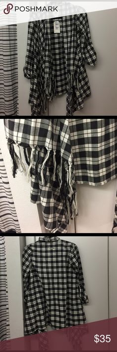 Plaid flannel wrap This a billabong black and white plaid flannel wrap! It is brand new and looks great on! It also can be paired with a bunch of different outfits. Billabong Tops